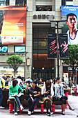Young women on a bench at shopping mall Central Plaza, Wanchai, Hongkong, China, Asia