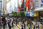 Pedestrians crossing the street in front of shopping center Central Plaza, Wanchai, Hong Kong, China, Asia