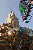 Facade of the Casino Hotel Grand Lisboa and neon sign of a pawnbroker, Macao, China, Asia