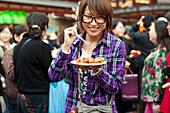 Smiling woman outside the Huxinting Teahouse, Yu Yuan Garden, Nanshi, Feng Shui, Shanghai, China, China, Asia