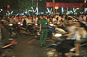 People driving scooters during the Tet festival at night, Saigon Ho Chi Minh City, Vietnam, Asia