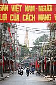 political banner and Vietnamese flags New Year festival, Tet, in a street, Cholon quarter, Saigon, Vietnam, Vietnam, Asia