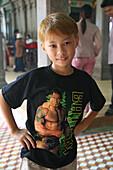 Vietnamese boy with wrestler fan t-shirt, Saigon, Vietnam, Vietnam, Asia