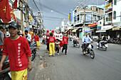 Teenagers at dragon dance during Tet festival at a suburb, Saigon, Ho Chi Minh City, Vietnam, Asia