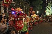 People at dragon dance during Tet festival at night, Saigon, Ho Chi Minh City, Vietnam, Asia