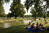 People sunbathing in English Garden, Munich, Bavaria, Germany, Europe