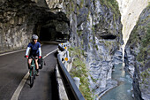 Cyclist in a cave of the Taroko gorge, Taroko National Park, Marble canyon, Liwu river, Tienhsiang, Tianxiang, Republic of China, Taiwan, Asia