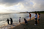 Teenagers and children on the beach at sunset, Kenting National Park, Kending, Kenting, Republic of China, Taiwan, Asia