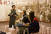 People at Taiwanese noodle restaurant Chi Kin Dandanmian, Tainan, Republic of China, Taiwan, Asia