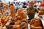 Woman selling bread at the Saturday market, Old Biscuit Mill in the Woodstock district of Capetown, Western Cape, RSA, South Africa, Africa