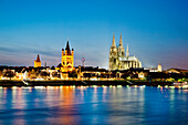 View over river Rhine to old town with cathedral and Great St. Martin church, Cologne, North Rhine-Westphalia, Germany