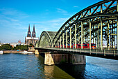 View over river Rhine with Hohenzollern bridge to cathedral, Cologne, North Rhine-Westphalia, Germany
