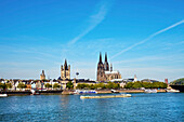 View over rive Rhine to old town with cathedral and Great St. Martin church, Cologne, North Rhine-Westphalia, Germany