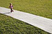 Florida,  Miami Beach,  Flamingo Park,  girl,  grass,  lawn,  plastic path,  mat,  running,  preschooler,  blonde