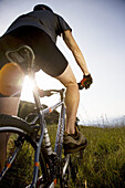 Italy Pedimont Lake Maggiore Young man on mountain bike MODEL RELEASE 1112
