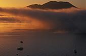Sunrise on yachts Acacia Bay Lake Taupo Mount Tahaura behind New Zealand