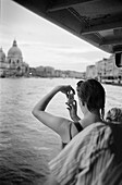 Adult, Adults, Architecture, b&w, back view, black-and-white, Camera, Cameras, Church, Churches, cities, city, Contemporary, Daytime, Digital camera, Dome, Domes, Europe, exterior, female, Hobbies, Hobby, Hold, Holding, holiday, holidays, human, Italy, Le