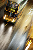 Blurred city bus moving in high speed on the street in Wanchai (Wan Chai),  Hong Kong,  China,  Southeast Asia