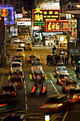 Busy street at night with cars moving along the street and colorful neon advertisements in chinese letters at Causeway Bay,  Hong Kong Island,  Hong Kong,  China,  Southeast Asia