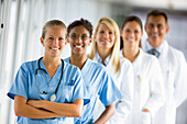 Adult, Adults, Arms crossed, Arms folded, Caucasian, Caucasians, Colleagues, Color, Colour, Cross arms, Cross-armed, Crossed arms, Crossing arms, Doctor, Doctors, Ethnic, Ethnic mix, Ethnic mixed, Ethnicity, Facing camera, female, Five, Five persons, grin