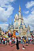 Crowd in front of Cinderella Castle at Walt Disney Magic Kingdom Theme Park Orlando Florida Central