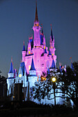 Evening illuminated view of Cinderella Castle at Walt Disney Magic Kingdom Theme Park Orlando Florida Central