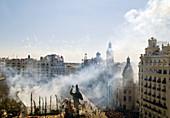Smoke over City Hall Square during ´mascletà´ fireworks,  ´Fallas´ festival,  Valencia. Comunidad Valenciana,  Spain,  2008