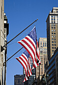 New York Offices and skyscrapers with stars and stripes flag flying outside USA