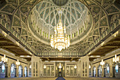 Architectural detail of the interior of the main prayer hall of the Sultan Qaboos Grand Mosque,  with the world´s largest Swarovski Crystal chandelier,  hanging from the domed ceiling,  Ghubrah,  Muscat,  Oman