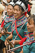Hani women playing local instruments at the Long Table Festival in Yuanyang China