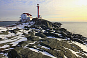 Winter scene with snow at Cape Forchu Lighthouse in Nova Scotia in Canada