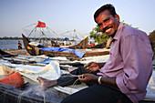 Fisherman working on a fishing net,  Fort Cochin,  Kerala