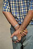 Man playing boules,  Gréoux-les-Bains. Alpes-de-Haute-Provence,  France