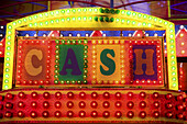 brightly lit fairground attraction offering cash prizes