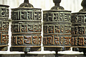 Nepal,  Kathmandu,  the great stupa of Swayambhunath,  prayer wheels