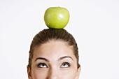 Adult, Adults, Apple, Apples, Askance, Balance, Brunette, Brunettes, Caucasian, Caucasians, Clipping path, Color, Colour, Contemporary, Dark-haired, Diet, Diets, Equilibrium, Female, Food, Foodstuff, Fruit, Fruits, Half, Halves, Head, Heads, healthy, heal