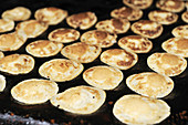 Traditional Poffertjes - Dutch pancakes being cooked