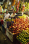 Men standing in their fresh produce shop  Alleppy,  Kerala,  India