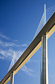France, Midi Pyrenees, Aveyron The Millau Viaduct is the tallest vehicular bridge in the world, with one mast's summit at 343metres It goes through the Tarn river valley near Millau Designed by the structural engineer Michel Virlogeux