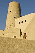 historic adobe fortification,  Bahla fort or castle,  UNESCO World Heritage Site,  Hajar al Gharbi Mountains,  Dhakiliya Region,  Sultanate of Oman,  Arabia,  Middle East
