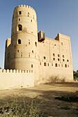 historic adobe fortification Bait Na´aman or Bait an Naman Fort or Castle near Barka,  Batinah Region,  Sultanate of Oman,  Arabia,  Middle East