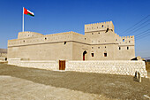 historic adobe fortification Mahadah fort or castle near Buraimi,  Hajar al Gharbi Mountains,  Al Dhahirah Region,  Sultanate of Oman,  Arabia,  Middle East