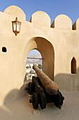 historic adobe fortification Nizwa Fort or Castle,  Hajar al Gharbi Mountains,  Dhakiliya Region,  Sultanate of Oman,  Arabia,  Middle East
