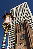 Lamp post,  Old St Marys steeple and an office tower in San Francisco´s Chinatown