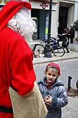 5 year old girl with Santa Claus