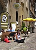Poland,  Krakow,  Art school students at Kanonicza street