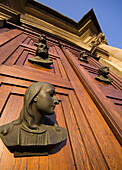 Poland Krakow,  main doors with heads of St Mary´s Church