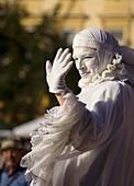 White Lady,  woman street performer at Main Market Square,  Krakow,  Poland