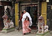 Nepal,  Kathmandu Valley,  Bhaktapur,  woman making religious ritual offering