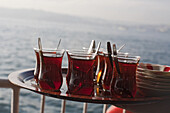 tea time on the Istanbul ferry, tulip-shaped glasses with black tea, spoons